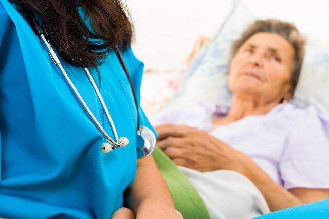 Nurse with Hospice patient