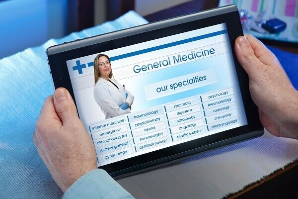 looking up health care options on tablet