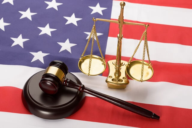 gavel and justice scale on a flag