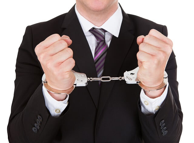 employee in handcuffs