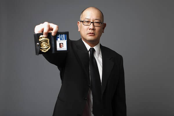 FBI agent showing badge