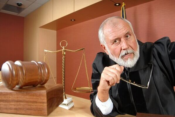 judge listening to aggressive lawyer