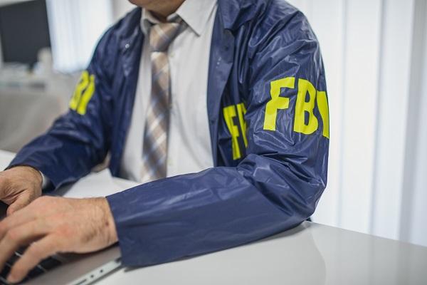 FBI Agent on Computer